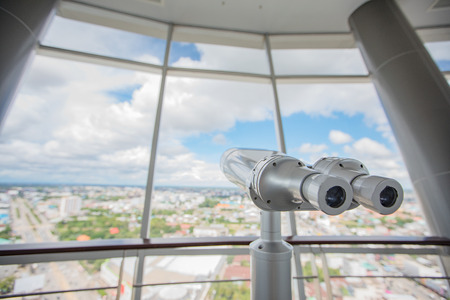 binocular on the top of building for Touristic telescope look at the city with view