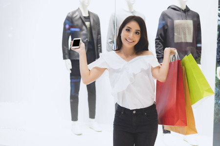 Asian women and Beautiful girl is holding shopping bags smiling while doing shopping in the supermarket/mall Фото со стока