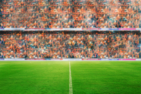 blurry and soft focus of football stadium and arena soccer field championship win for background Imagens