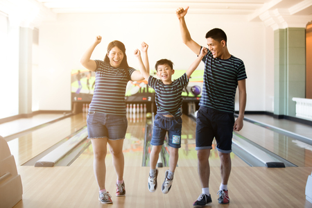 Family having fun at bowling club after skittles bowling ball ,blurry and soft focus