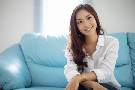 Asian women smiling happy for relaxation on sofa at home