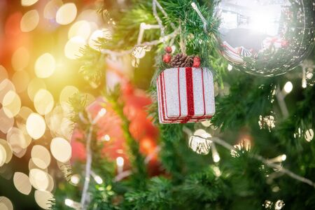Happy new year and ornaments on the Christmas tree with gift box ,blurred and soft focus