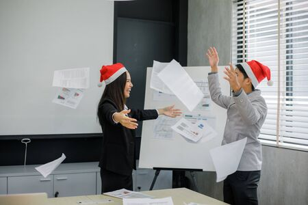 Asian businessmen and businesswomen Success and winning concept - happy team with raised up hands celebrating the breakthrough and achievements Stok Fotoğraf