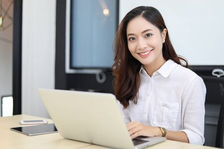Asian business women using notebook and  smiling happy for working