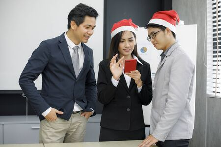 Asian businessmen and group using mobile phone for business partners discussing documents and ideas at meeting and business women smiling happy for working Stok Fotoğraf