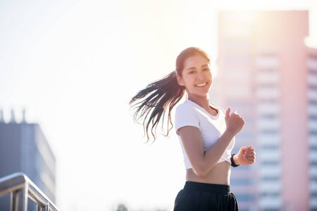 smiling Asian Young fitness sport woman running and Sportive people training in a urban area, healthy lifestyle and sport concepts