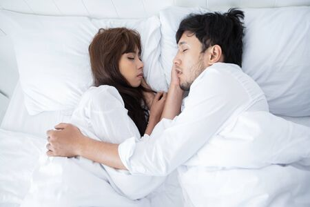 couples lover Laying On Bed Happiness Lifestyle and smiling girl relaxing at home