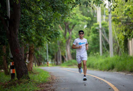 Asian men jogging and running in the park
