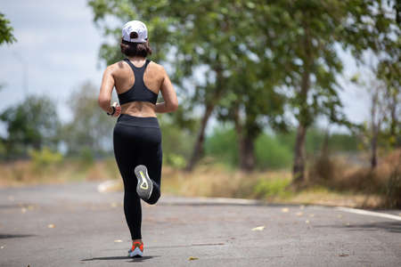 Asian women Running and jogging during outdoor on park