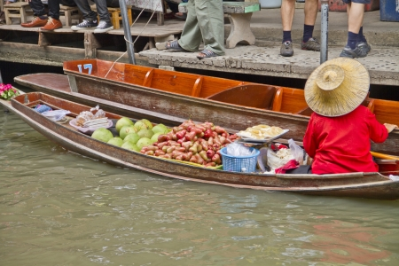saduak: Fruit vendor at Damnoen Saduak Floating Market, Thailand Editorial
