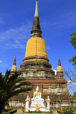 Pagoda and Buddha Status at Wat Yai Chaimongkol, Ayutthaya, Thailand  photo