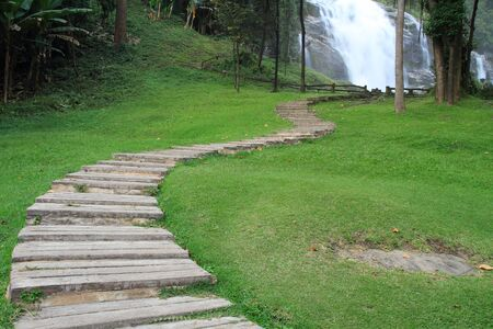 Wooden Walking Path Through waterfall Stock Photo - 16984905