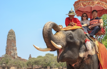 AYUTTHAYA, THAILAND - MARCH 7  Tourists on an elephant ride tour of the ancient city on March 7, 2013 in Ayutthaya