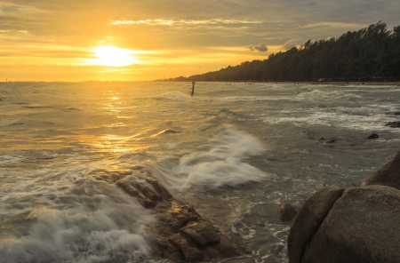 beautiful sunset and Ocean waves in the tropical sea