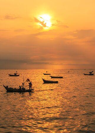 silhouette image of fishing boat at beautiful sunset  photo