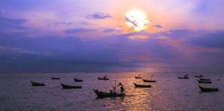 silhouette image of fishing boat at beautiful sunset  photo