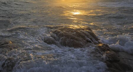 Beautiful sunset and sea waves of the natural Stock Photo - 20951148