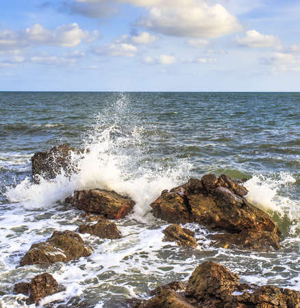 ocean waves crashing onto the rocky shore photo
