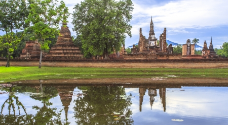 Reflections Beautiful scenery  of Mahathat Temple, Sukhothai Historical Park, Sukhothai Province, Thailand photo