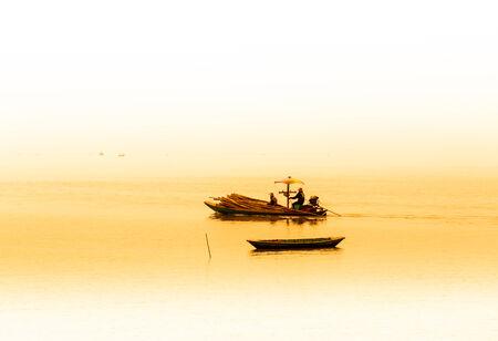 turbid: Fishermen collecting shellfish at cockle farming area in the sea  Stock Photo