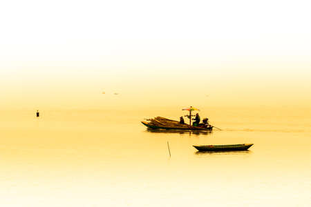 farming area: Fishermen collecting shellfish at cockle farming area in the sea  Stock Photo