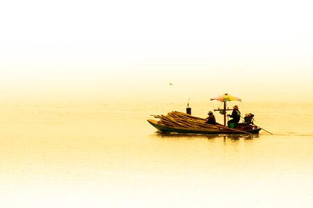 farming area: Fishermen collecting shellfish at cockle farming area in the sea  Editorial