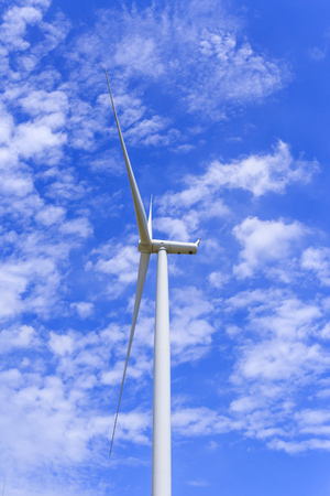 Wind Turbine for alternative energy on background blue  sky