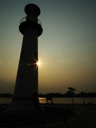 illuminative: illustration of Lighthouse on sunset Stock Photo
