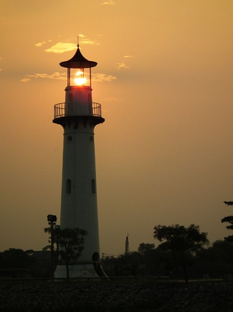 beacons: illustration of Lighthouse on sunset Stock Photo
