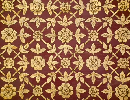 flower pattern in traditional Thai style art on wall of the temple photo