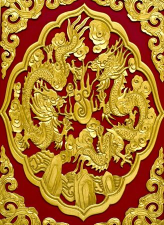 gold dragon on red background photo