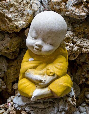 Earthenware of child monk Stock Photo - 13412140