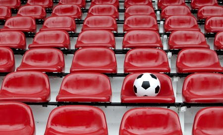 Rows of red football stadium seats with numbers photo