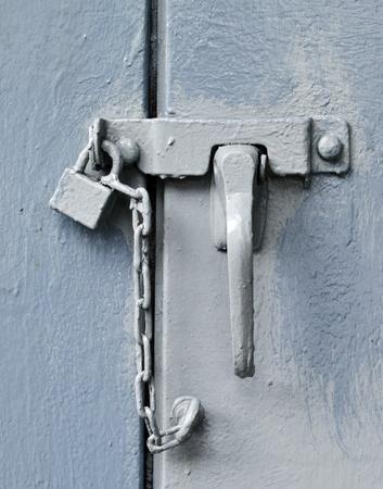 Padlock on blue door photo