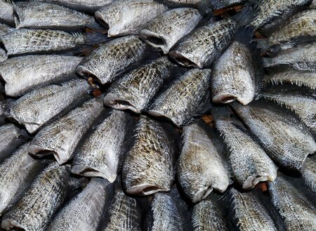 Fish drying on a wooden stretcher mole Thai food photo