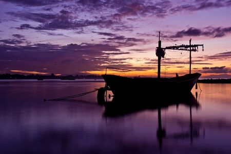 Fishing boat before the sunset in south of thailand nice photo