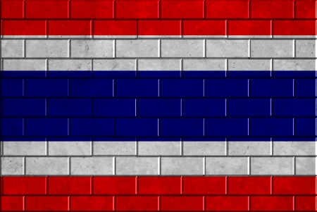 Thailand flag painted on old brick wall texture background photo