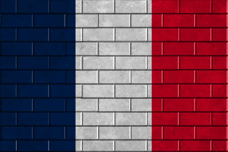 An image of the France flag painted on a brick wall in an urban location photo