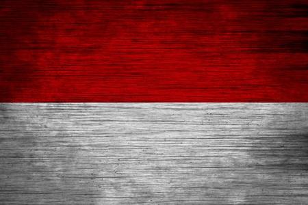 Indonesia flag on wood texture photo