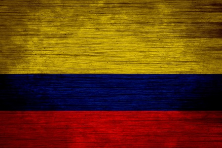Colombia flag on wood texture photo