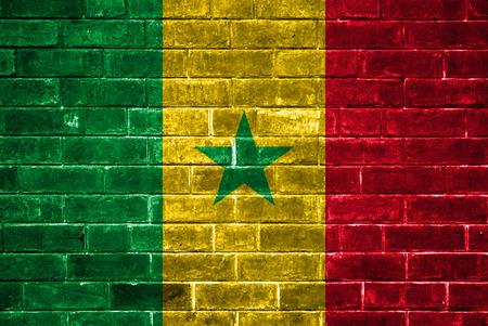 Senegal flag painted on a brick wall photo