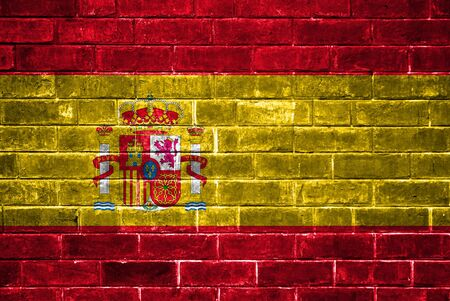 Spain flag painted on a brick wall photo