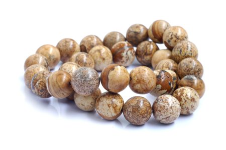 nicety:  beads closeup isolated on white Stock Photo