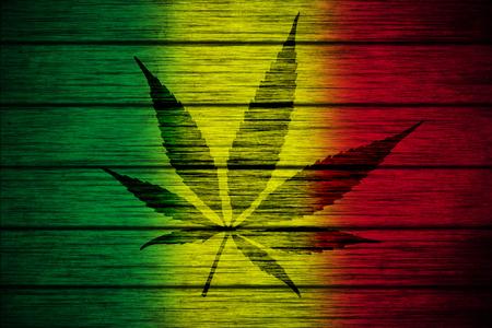 Background texture wood Rasta Flag with Marijuana Leaf silhouette photo