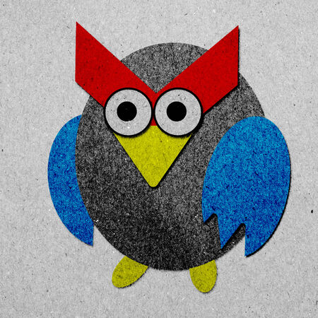 Owl made from recycled paper background photo
