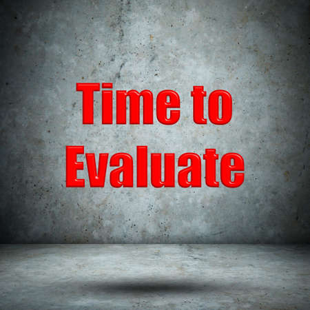 reevaluation: Time to Evaluate concrete wall Stock Photo