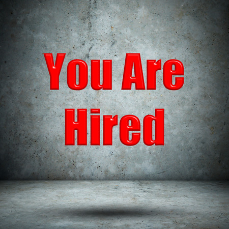 employment elementary school: You Are  Hired concrete wall Stock Photo
