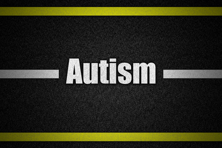 Traffic  road surface with text Autism photo