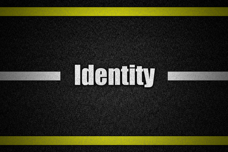 existence: Traffic  road surface with text Identity Stock Photo