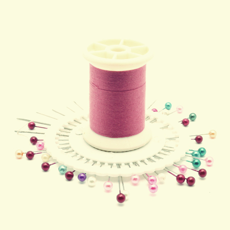 thread and needle in old vintage retro style photo
